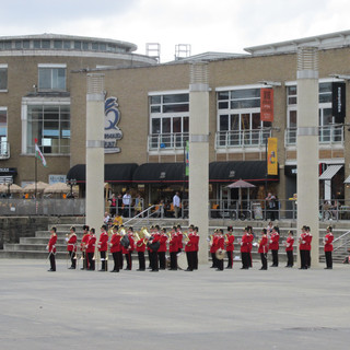 The Band of the King's Division in front of Mermaid Quey eating quater on the Roald Dahl Plass
