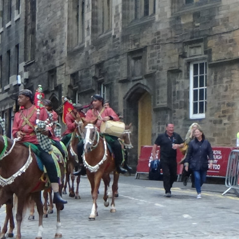 The Mounted Pipers of The Royal Cavalry of the Sultanate of Oman riding down Castle Hill and around The Hub at the end of their dress rehearsal on Thursday 2nd August