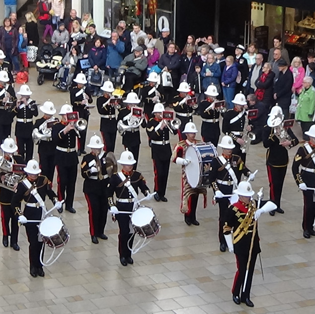The Band of HM Royal Marines Plymouth leaving Cabot Circus after performing for Bristol Poppy Day 2018