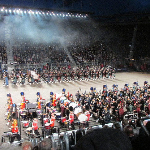 The Massed Pipes and Drums marching on at the end to join the massed bands