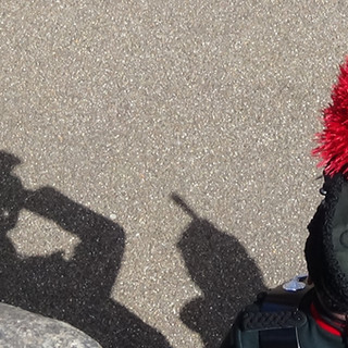 A Bugler from The Rifles, creating shadows in the Bank Holiday sunshine