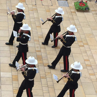 The Band of HM Royal Marines Plymouth back ranks, with the remainder of their Cornet Section, Clarinet section and their piccolo player