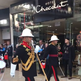 The Drum Major and Director of Music, leading the band out of the shopping center