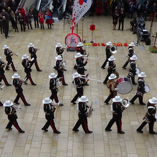 The Band of HM Royal Marines Plymouth performing The World in Union as a slow march in Cabot Circus