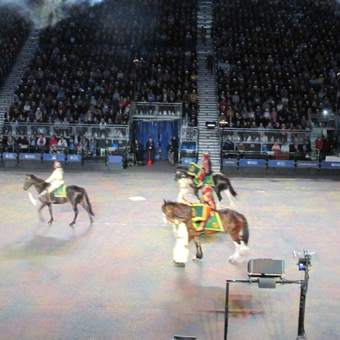 The Combined Bands of the Royal Cavalry of the Sultanate of Oman riding into the arena. The band was formed of a mounted Pipes and Drums and then a 70 strong all female marching band.