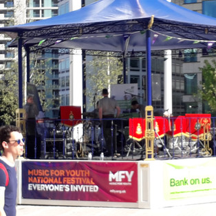 The RM Portsmouth Band's Function Band setting up on the Centenary Square Music For Youth Festival Bandstand.