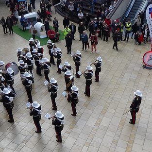 The Band of HM Royal Marines Plymouth counter marching, before leaving Cabot Circus performing the regimental marches of the Royal Navy and Royal Marines Band Service - Heart of Oak and A Life on the Ocean Wave