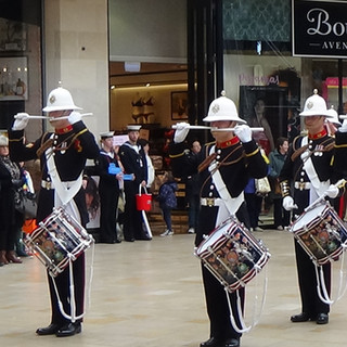 The Corps of Drums of the Band of HM Royal Marines Plymouth delighting shoppers to a complex show of complex, rudimental drumming