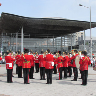 The Band of the King's Division with The Natoinal Assembly for Wales in the backround