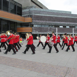 The Band of the King's Division marching past The Wales Millenium Center Cafe