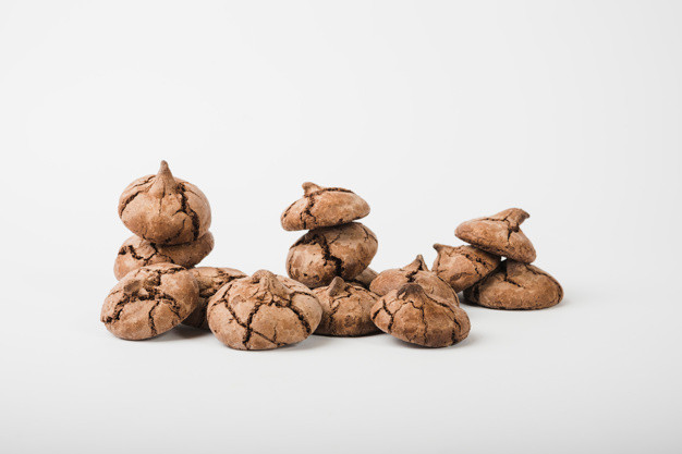 Many cocoa cookies isolated on white backdrop Free Photo