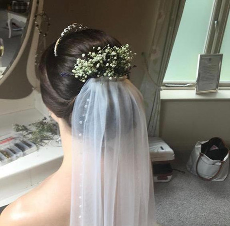 Stunning updo with floral veil