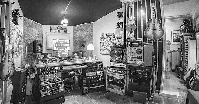 The control-room of professional recording studio where recordings are made and we mix songs by alternative rock artists and bands