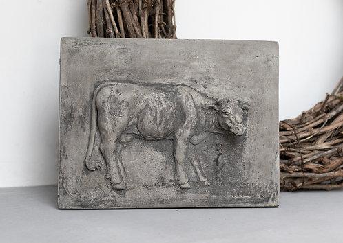 Betonnen bord met koe