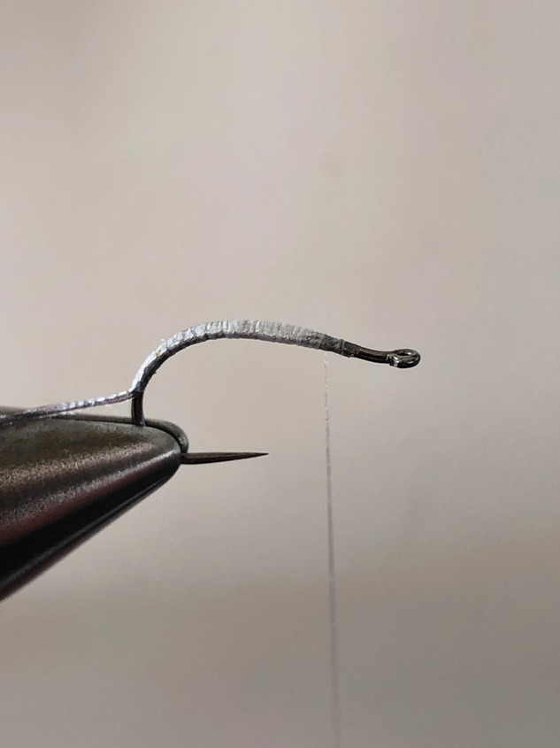 Step 3, make from your tying thread a nice body, and wind first the PQ to the front and then the Micro Metal as a rib to the front