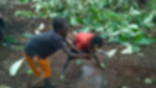 The school children enjoy the running water from the solar powered well.