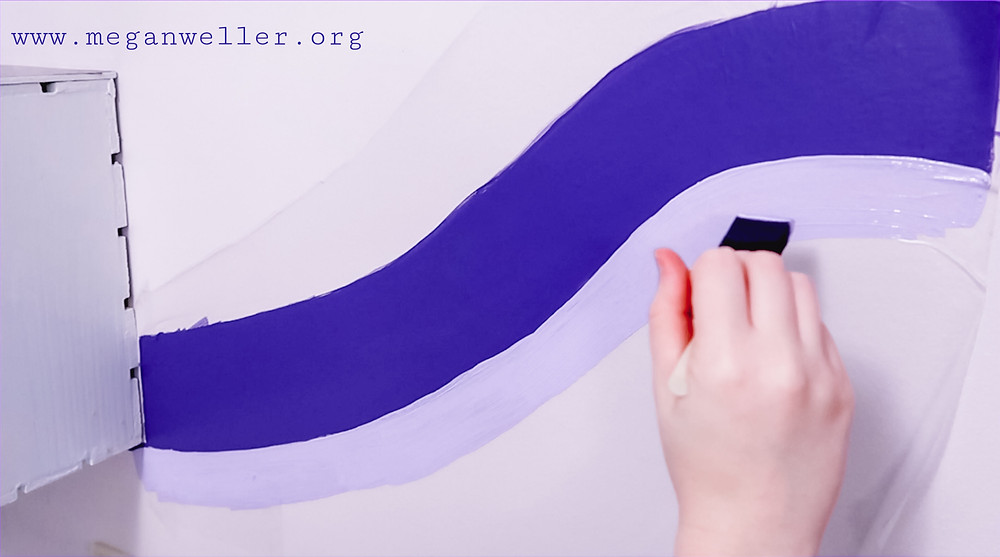 Painting stripes on shelf liner to create a homemade removable wall decal