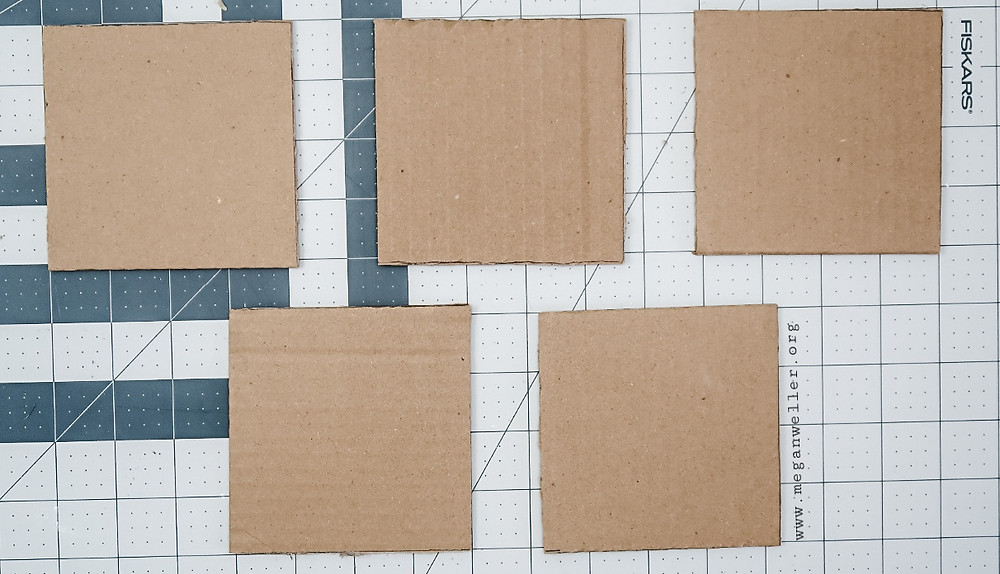 Cut 5 squares of cardboard that are the same size.