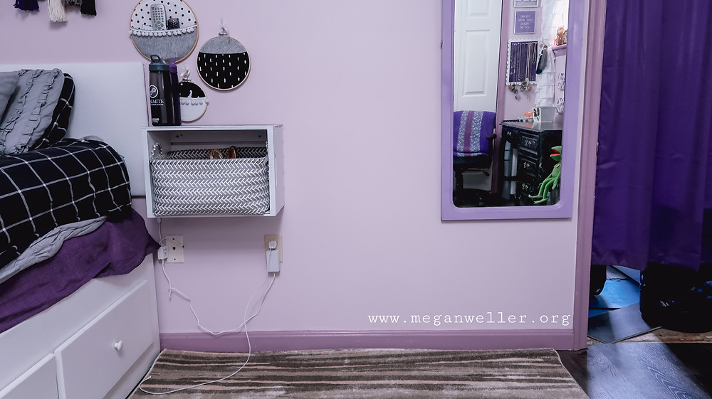 """""""before"""" picture of the wall beside my bed. Featuring a bedside table made from a wooden craft, some embroidery hoop wall pockets, and a full length mirror."""