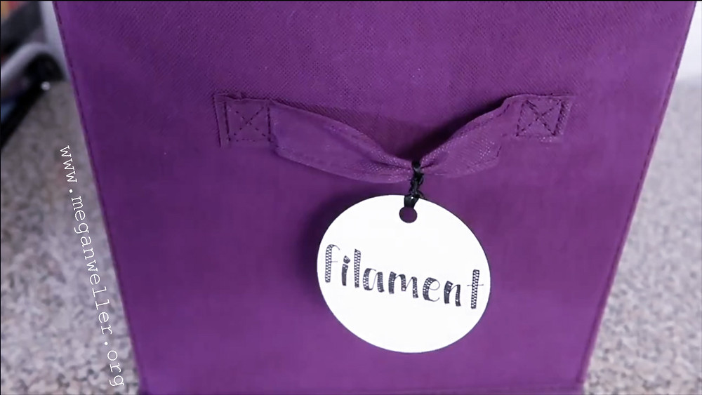 Purple Fabric storage bin with a label made with cardstock, a Cricut maker, and a Cricut pen.