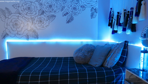 DIY LED Light Up Headboard glowing on the blue setting.