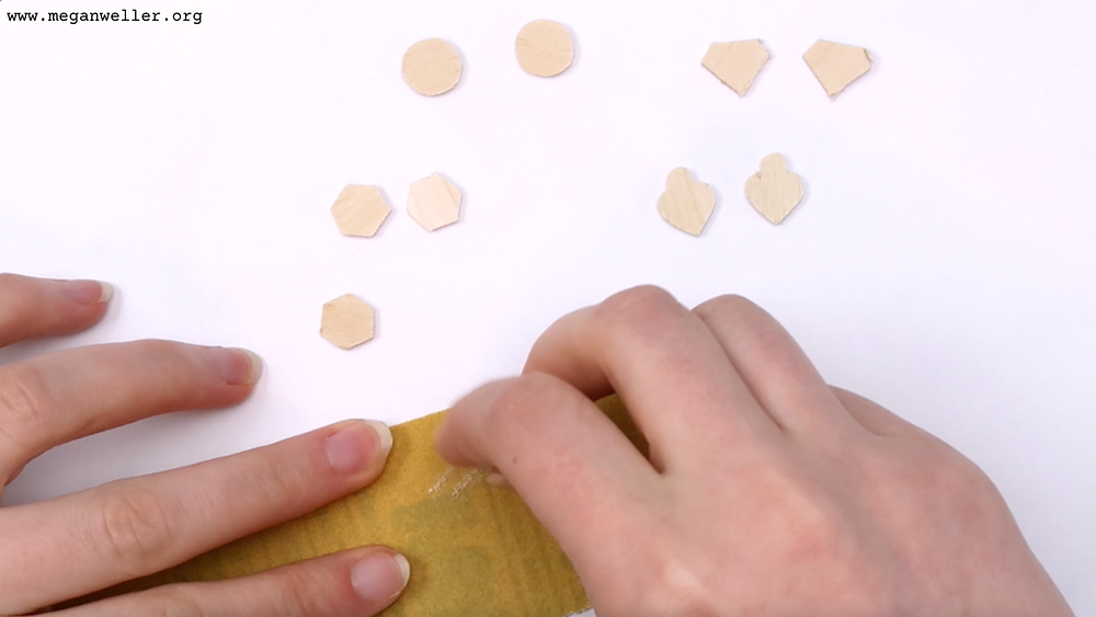 Sand down the edges of the basswood earrings.