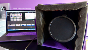 Using a DIY Portable sound booth with iMovie on a 2018 MacBook Pro with a Silver YouTube Play Button.