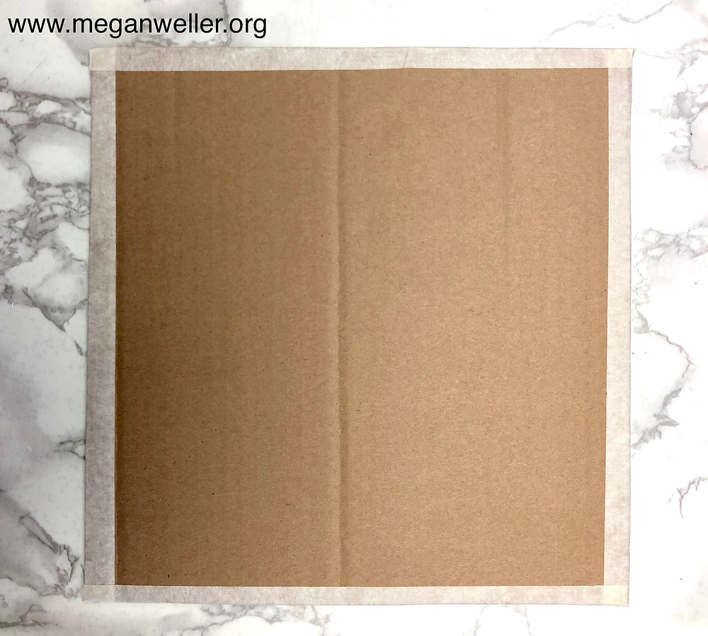 Cardboard with masking tape around the edges