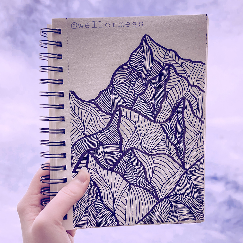Mountain drawing done with micron pens, sitting against a cloud background.