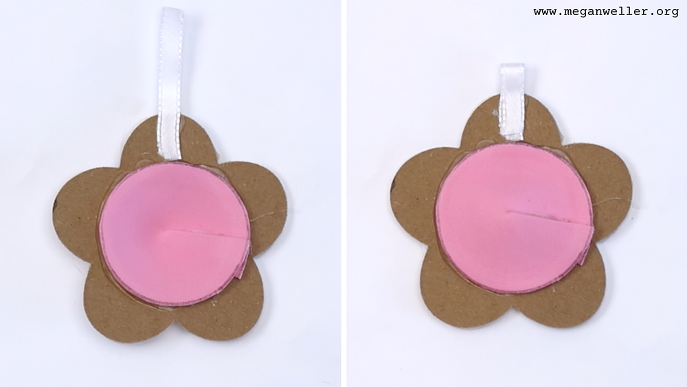 Glue on a small piece of ribbon to make a pop it keychain.