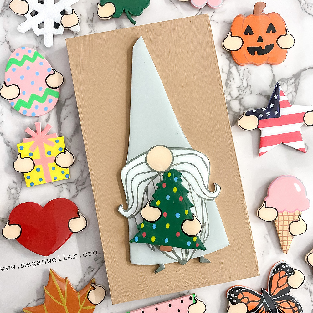 Chipboard gnome decoration made with a Cricut Maker, chipboard, and the Cricut knife blade. Painted with acrylic paint.