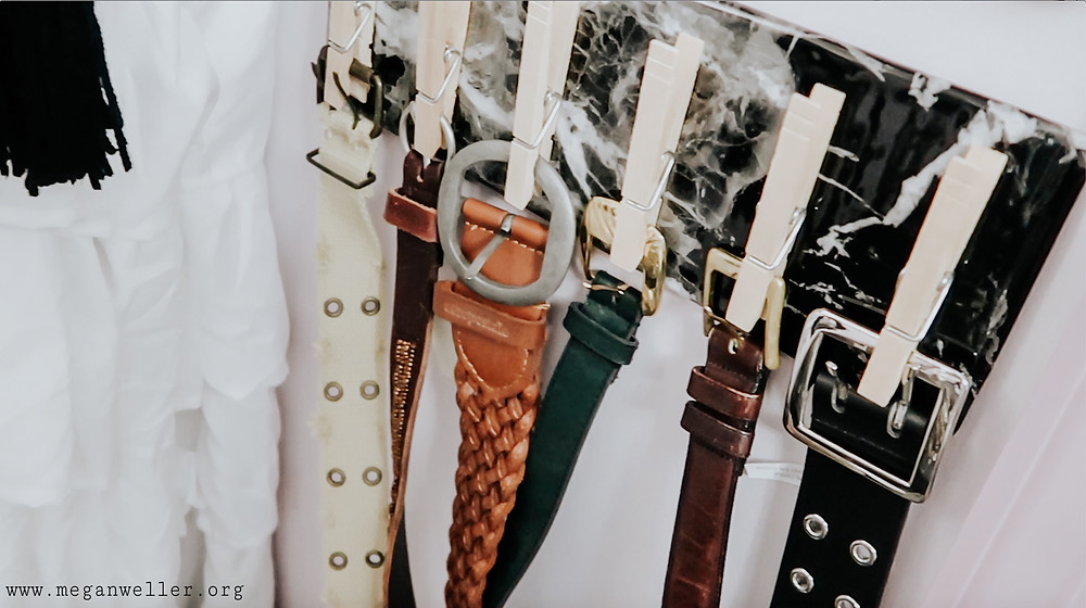 How to organize belts with a DIY Clothespin Wall Organizer.