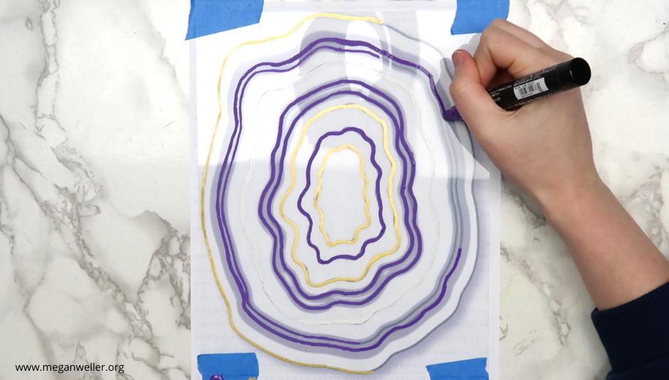 Trace the outline of the geode with purple, gold, and white Posca Pens.