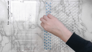 place the perler beads on your pegboard with a few space in between each bead.