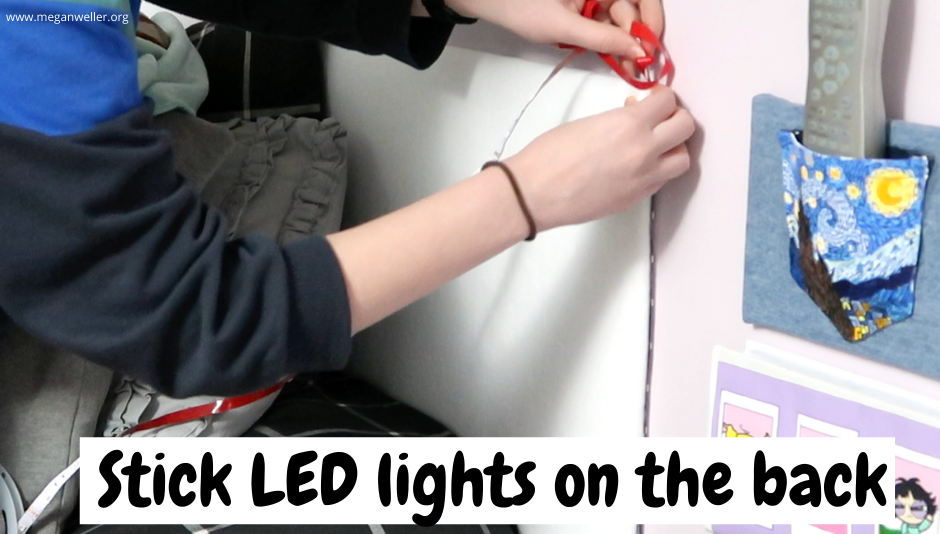Placing self adhesive LED lights on the back of a homemade headboard.