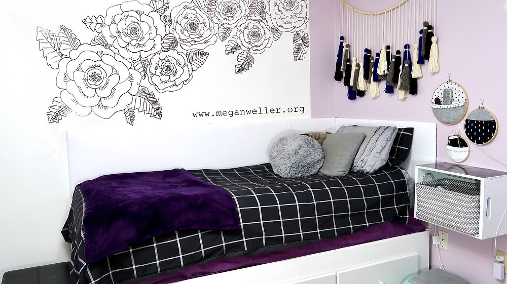 DIY Purple Aesthetic Teen College Bedroom Decor. Whiteboard wall, yarn tassel garland, embroidery hoop wall pockets, floating night stand, DIY headboard, LED lights, bed with drawers, grid bedding, wall mural.