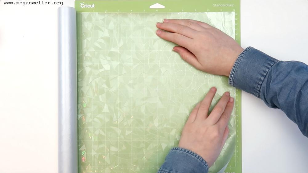 Put the window film on your Cricut StandardGrip mat.