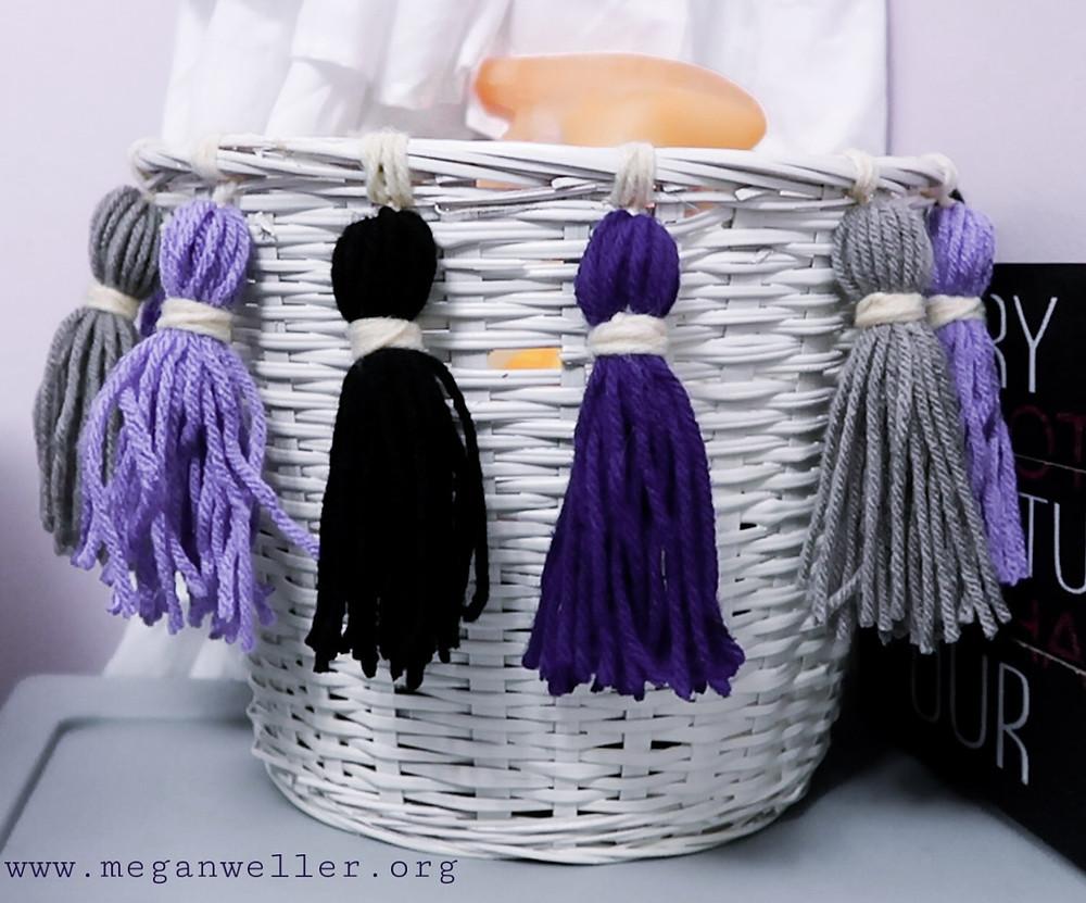 Basket with yarn tassels