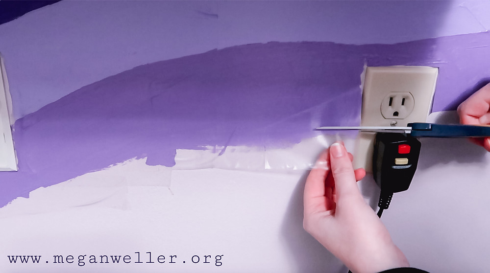 After the paint dries, cut off any excess contact paper around the edges of your painting.