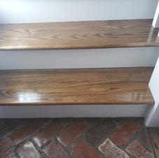 Construction remodeling project - solid oak treads and white risers
