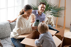 happy-family-with-kids-unpacking-boxes-m