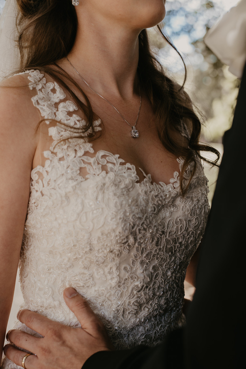 Nina Wearing bespoke Luke Archer lace and tulle couture Wedding gown and  tulle tiered veil. Close up lace detailing