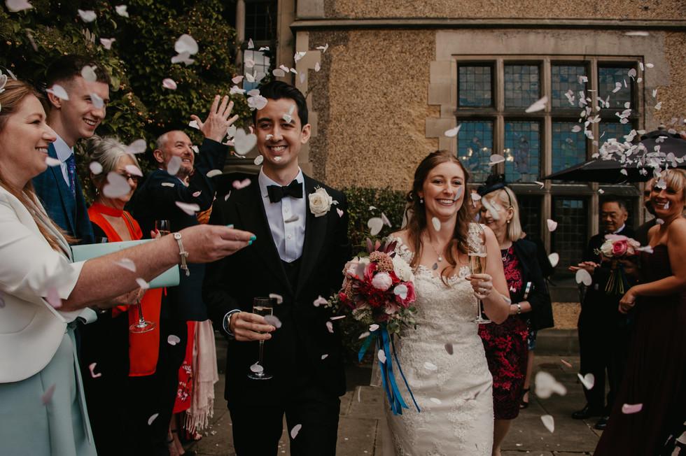 Bride and groom under the confetti.