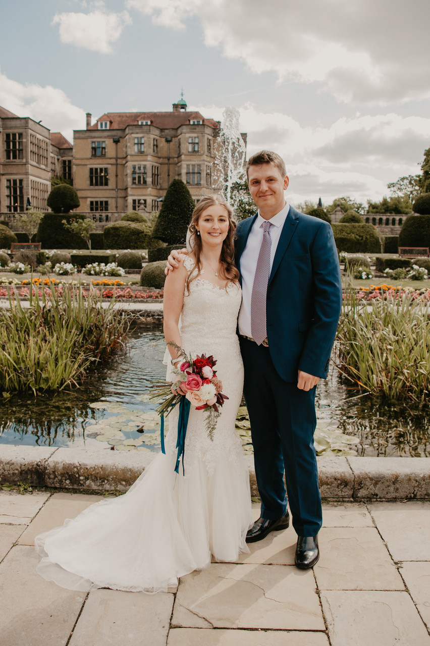 Nina Wearing bespoke Luke Archer lace and tulle couture Wedding gown at venue.