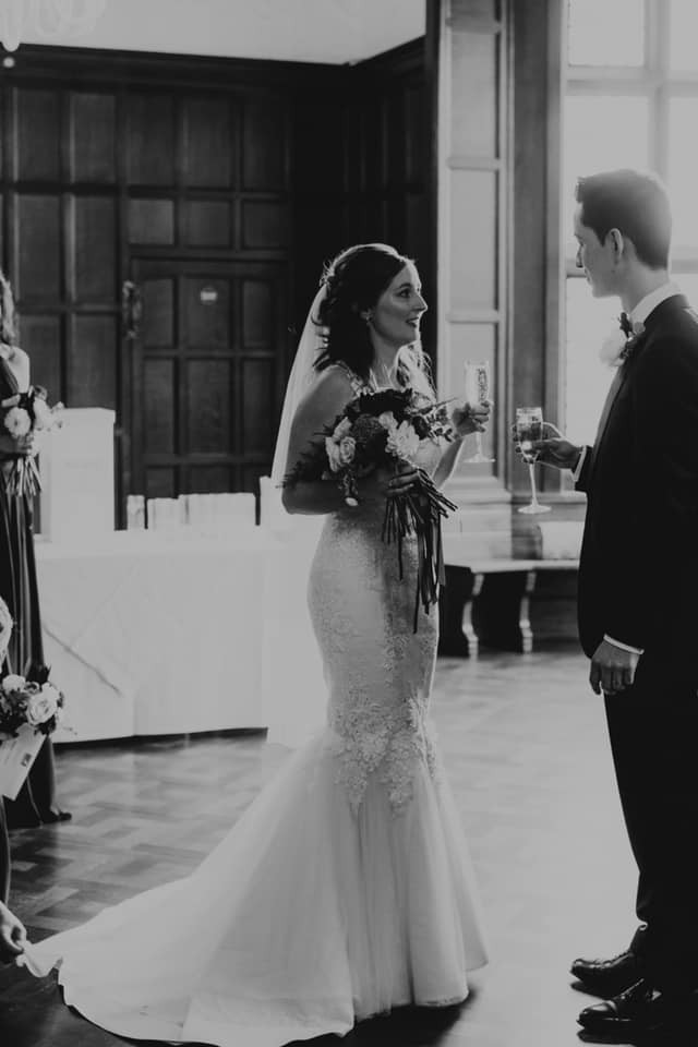 Nina Wearing bespoke Luke Archer lace and tulle couture Wedding gown and tulle tiered veil with the groom.