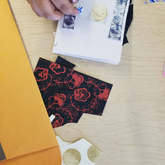 Students creating a collage for one of their book covers.