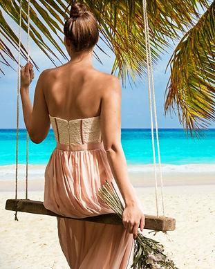 woman-on-swing-caribbean-beach-and-sea-1