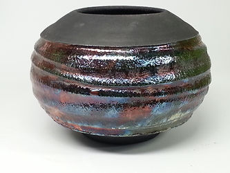 Black textured pot with metallic flashes