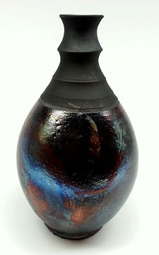 Curved pot with black top and raku bottom