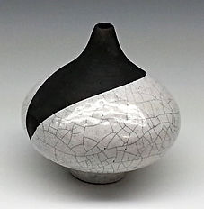 Small white crackle pot with black top
